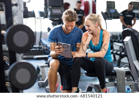 smiling personal trainer using...