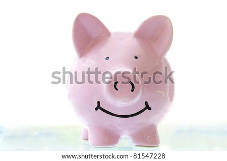 smiling pink piggy bank, on white