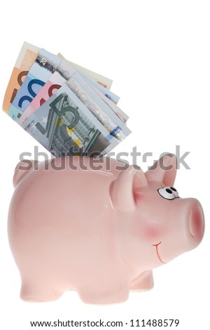 Smiling Pink piggy bank with Euro bank notes isolated on white background