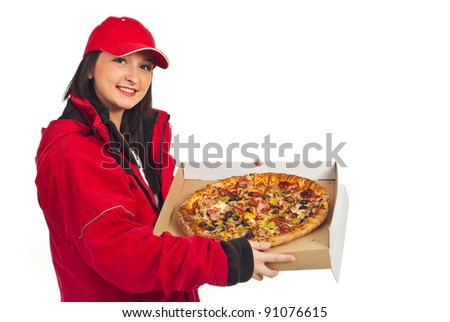 Smiling pizza delivery woman in red cap and coat holding pizza isolated on white background