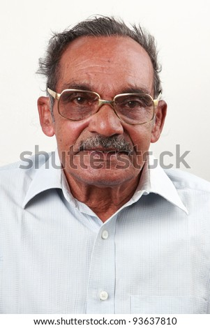 Smiling portrait of an Indian senior man
