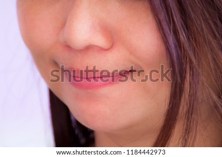 Smiling portrait of Asian girl. / Close up mouth of smile. / Happy smile. #1184442973