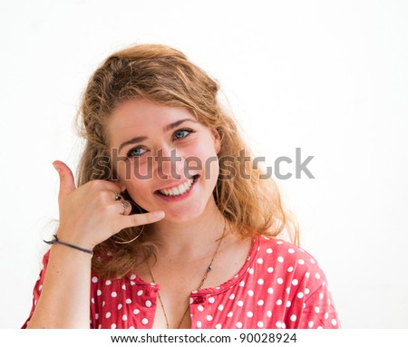 smiling portrait young woman talk on a cellular telephone
