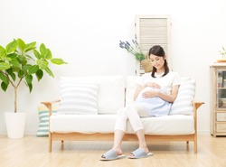 smiling pregnant Japanese woman