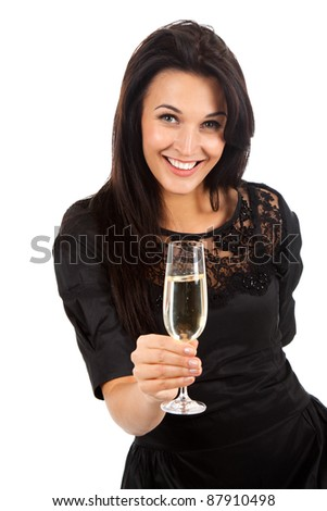 Smiling pretty woman standing holding a glass of champagne. Isolated over white background