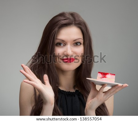 Smiling pretty woman with the cake, closeup portrait