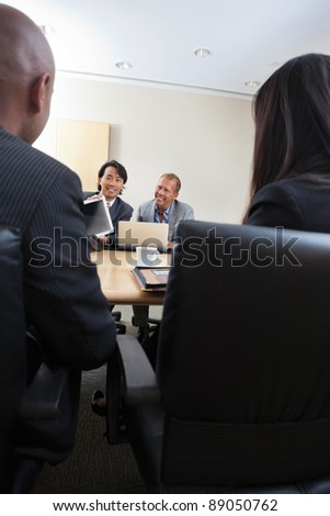 Smiling professionals in a business meeting