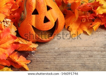 Smiling pumpkin head on wooden background with copy space