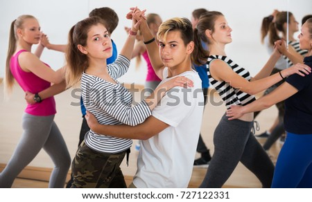 Smiling pupils  dancing salsa in the hall #727122331