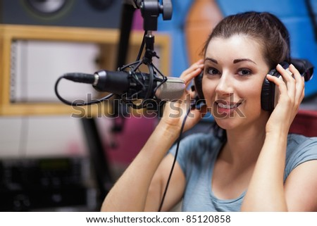 Smiling radio host posing in a station
