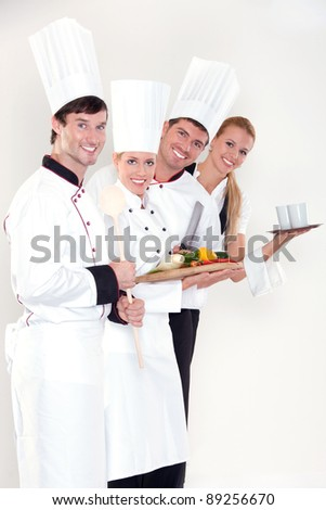 Smiling restaurant staff - stock photo