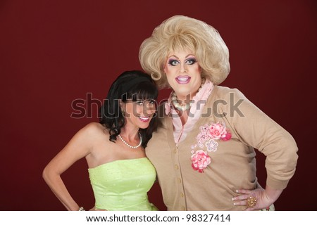 Smiling retro-styled woman with drag queen over maroon background