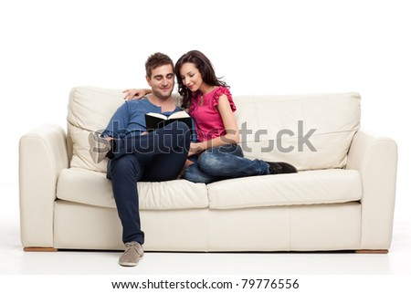 smiling romantic couple riding from the same book