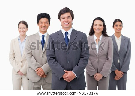 Smiling salesteam standing against a white background