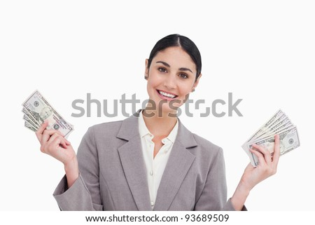 Smiling saleswoman with money in her hands against a white background