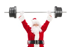 Smiling Santa Claus lifting a heavy barbell and looking at camera isolated on white background