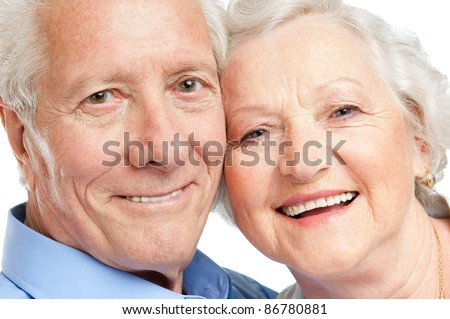 Smiling satisfied senior couple looking together at camera closeup
