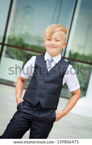 Smiling schoolboy in classic suit