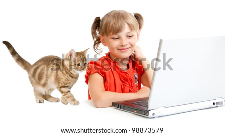 smiling schoolgirl sitting at notebook with kitten