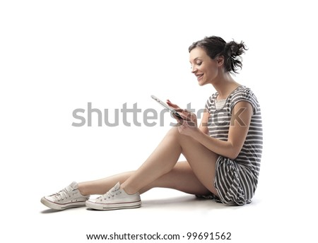 Smiling seated young woman using a tablet pc
