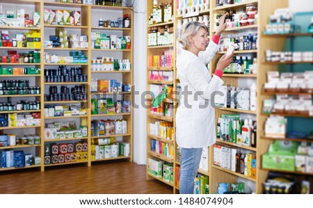 Smiling seller offering products of skin care in specialized shop