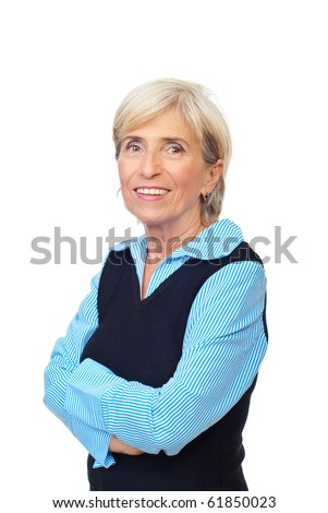 Smiling senior business woman standing in semi profile with arms folded isolated on white background