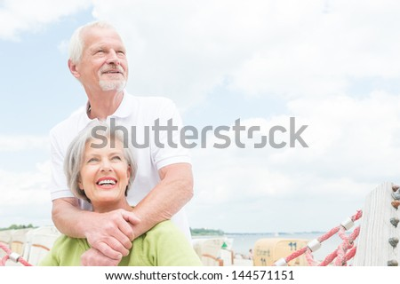 Smiling senior couple at the beach