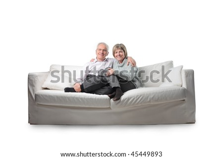Smiling senior couple sitting on a couch