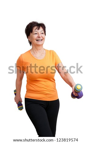 Smiling senior fitness woman exercising with barbells - isolated on white