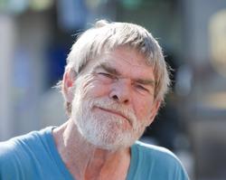 Smiling senior man outdoors during the daytime
