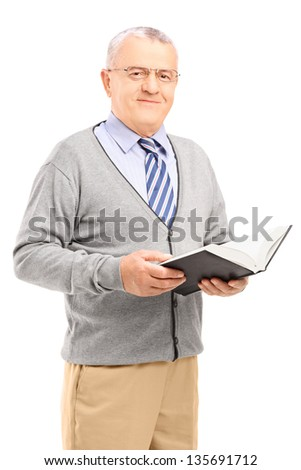 Smiling senior man reading a book, isolated on white background