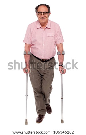 Smiling senior man walking with two crutches. All on white background