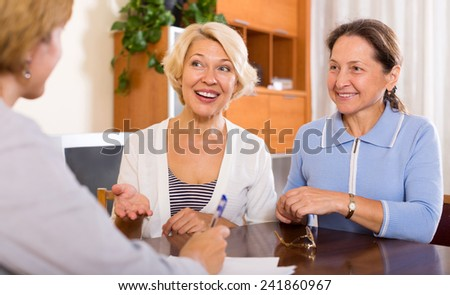 Smiling senior women consulting at insurance agent office. #241860967