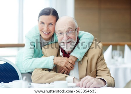 Smiling seniors spending time in cafe or restaurant #665354635