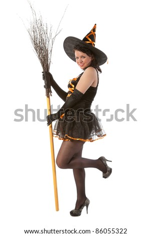 smiling sexy girl in Halloween witch with broom