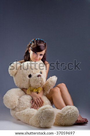 Smiling sexy woman with toys