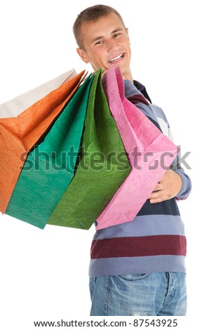 smiling shopping young man with bags, white background