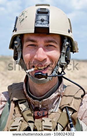 smiling soldier smoking a cigarette