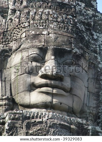 Smiling stone faces in the temple of Bayon, Angkor Wat, Siem Riep, Cambodia