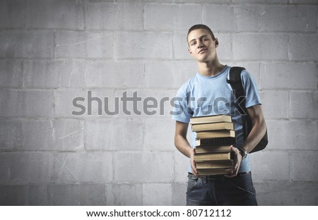 Smiling student carrying some books