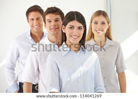Smiling successful business team standing in a row