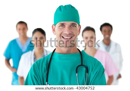 Smiling surgeon in front of his team against a white background