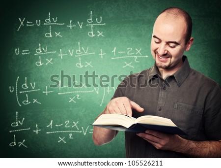 smiling teacher and classic blackboard