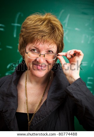 smiling teacher with glasses