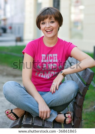 smiling teen girl on the bench