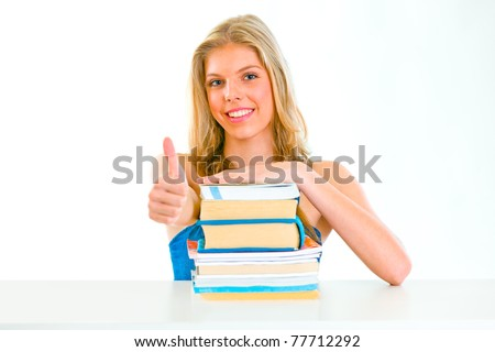 stock photo smiling teen girl sitting at table with books and showing thumbs up gesture 77712292 nude male art gallerys. Male Nude on Chaise Longue,flirty topless teen young ...