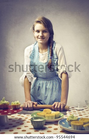 Smiling teenage girl baking sweets