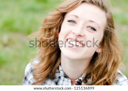 Smiling teenage girl had shot portrait