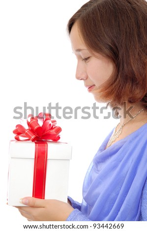 Smiling teenage girl holding a gift in her hands