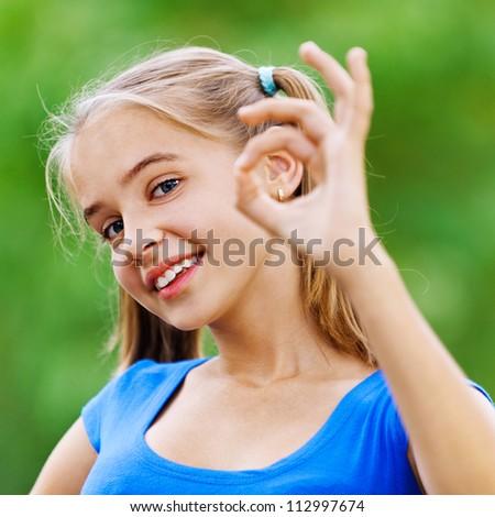 smiling teenage girl in blue...